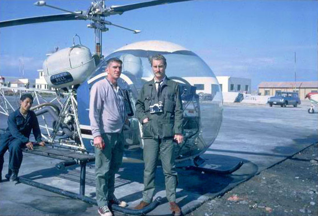 Gene Savoy Sr. outside of helicopter with pilot